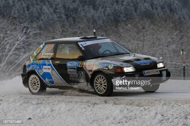 Steven Schierlinger of Austria and Peter Medinger of Austria in their Mazda 323GTR 4WD during the Jaenner Rallye at Freistadt on January 4 2019 in...