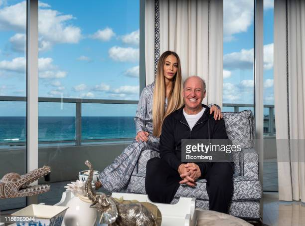 Steven Schonfeld chief executive officer and founder of Schonfeld Group Holdings LLC and his wife Brooke Schonfeld sit for a photograph in Palm Beach...