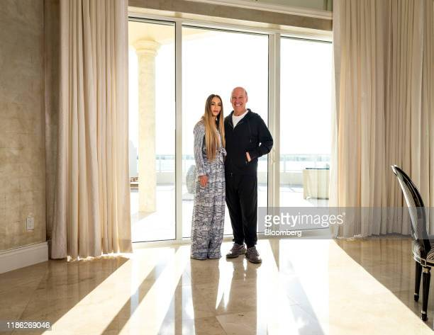 Steven Schonfeld chief executive officer and founder of Schonfeld Group Holdings LLC and his wife Brooke Schonfeld stand for a photograph in Palm...