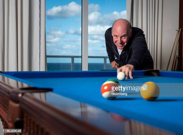 Steven Schonfeld chief executive officer and founder of Schonfeld Group Holdings LLC plays pool in an arranged photograph taken in Palm Beach Florida...