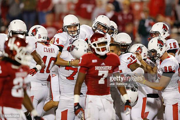Steven Schott of the Ball State Cardinals celebrates with teammates after kicking a 42yard field goal as time expires against the Indiana Hoosiers...
