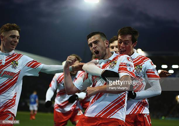 Steven Schumacher celebrates scoring his teams first goal with teammates during the Sky Bet League Two match between Portsmouth and Stevenage at...