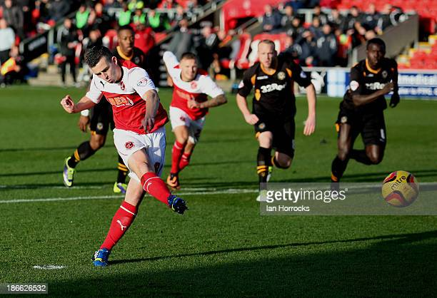 Steven Schumacher of Fleetwood Town scores the first goal from the penalty spot during the Sky Bet League two match between Fleetwood Town and...