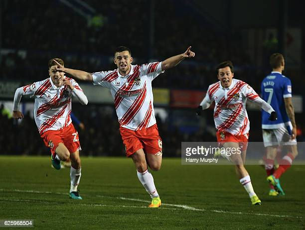 Steven Schumacher of Stevenage celebrates scoring his teams first goal during the Sky Bet League Two match between Portsmouth and Stevenage at...