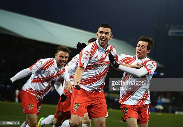Steven Schumacher of Stevenage celebrates scoring his teams opener with teammates during the Sky Bet League Two match between Portsmouth and...