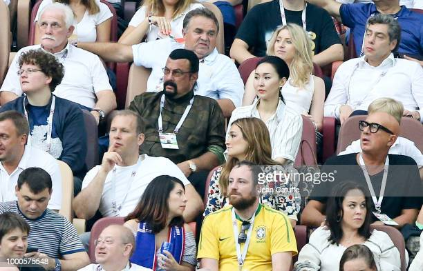 Steven Seagal and his wife Erdenetuya Seagal attend the 2018 FIFA World Cup Russia Final match between France and Croatia at Luzhniki Stadium on July...