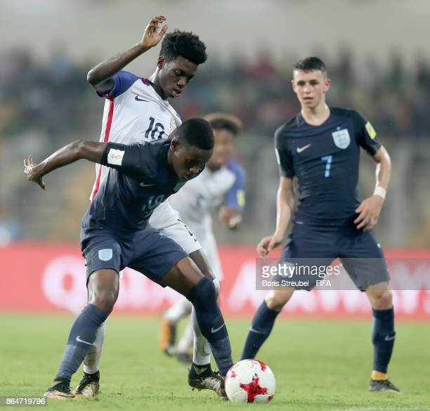 Steven Sessegnon of England is challenged by Tim Weah of the United States during the FIFA U17 World Cup India 2017 Quarter Final match between USA...