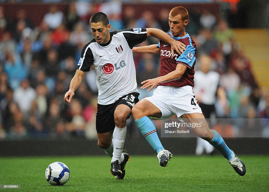 Steven Sidwell of Aston Villa challenges Clint Dempsey of Fulham during the Barclays Premier League match between Aston Villa and Fulham at Villa Park on August 30, 2009 in Birmingham, England.