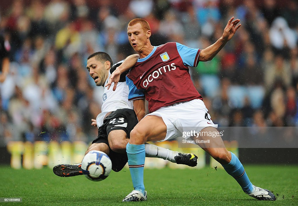 Steven Sidwell of Aston Villa is challenged by Clint Dempsey of Fulham during the Barclays Premier League match between Aston Villa and Fulham at Villa Park on August 30, 2009 in Birmingham, England.
