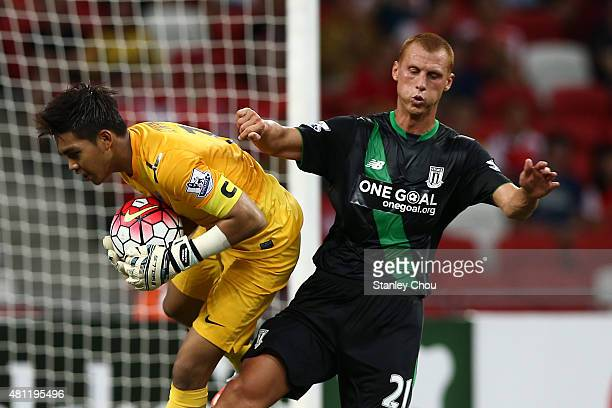 Steven Sidwell of Stoke City clashes with Izwan Mahbud of Singapore during the Barclays Asia Trophy 3rd placing match between Stoke City and...