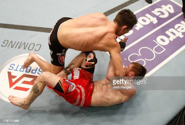 Steven Siler knocks out Mike Brown with a series of punches on the ground in their UFC featherweight bout at TD Garden on August 17 2013 in Boston...