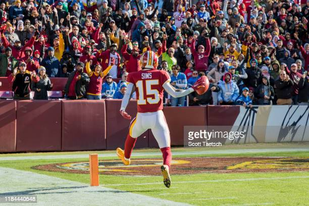 Steven Sims of the Washington Redskins celebrates as he returns a kick for a touchdown against the Detroit Lions during the first half at FedExField...