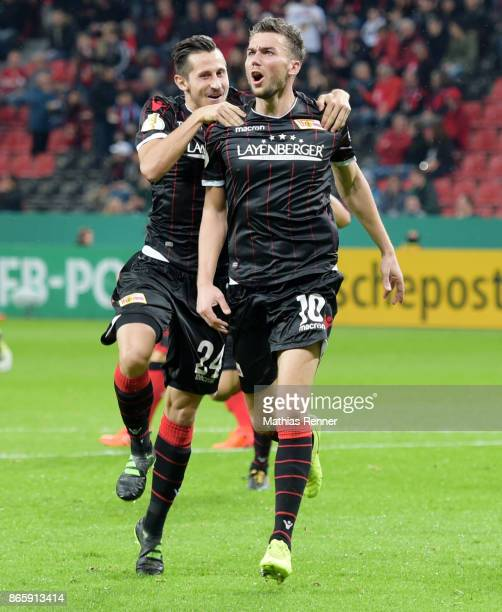 Steven Skrzybski and Dennis Daube of 1FC Union Berlin celebrate after scoring the 11 during the game between Bayer 04 Leverkusen and Union Berlin on...