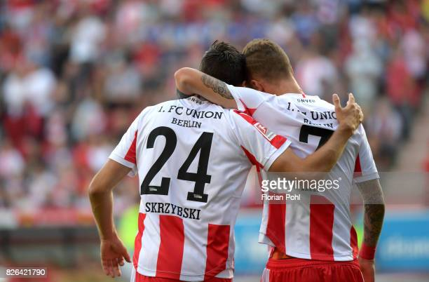 Steven Skrzybski and Marcel Hartel of 1 FC Union Berlin celebrate das Tor during the game between Union Berlin and Kieler SV Holstein on august 4...