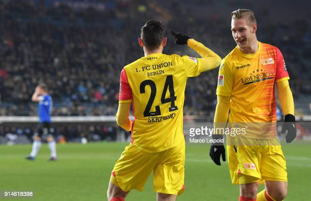 Steven Skrzybski and Sebastian Polter of 1FC Union Berlin celebrate after scoring the opening goal during the Second Bundesliga match between DSC...