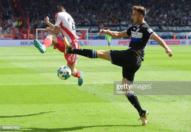 Steven Skrzybski of 1 FC Union Berlin and Andraz Sporar of Arminia Bielefeld during the game between Union Berlin and Arminia Bilefeld on august 27...
