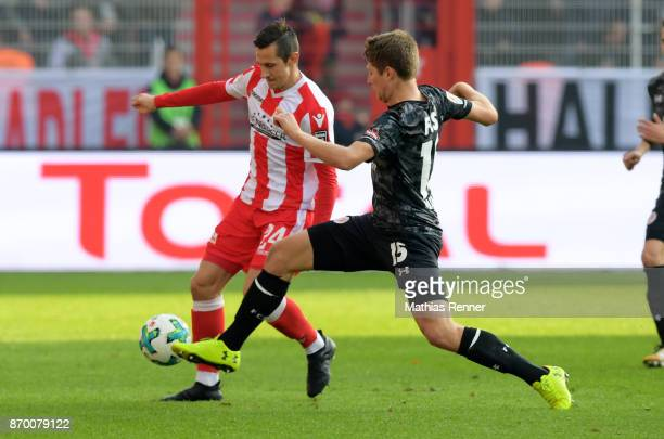 Steven Skrzybski of 1 FC Union Berlin and Daniel Buballa of FC StPauli during the game between Union Berlin and dem FC St Pauli on november 4 2017 in...