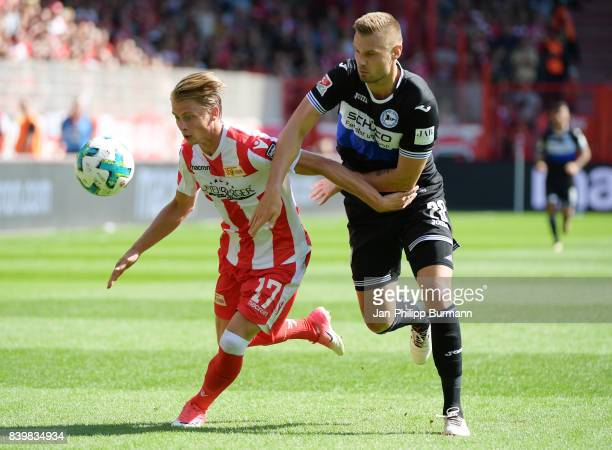 Steven Skrzybski of 1 FC Union Berlin and Florian Hartherz of Arminia Bielefeld during the game between germany and france on august 27 2017 in...