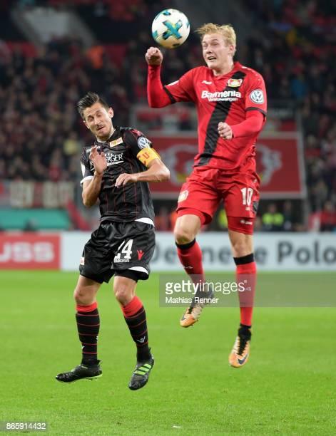 Steven Skrzybski of 1 FC Union Berlin and Julian Brandt of Bayer 04 Leverkusen during the game between Bayer 04 Leverkusen and Union Berlin on...