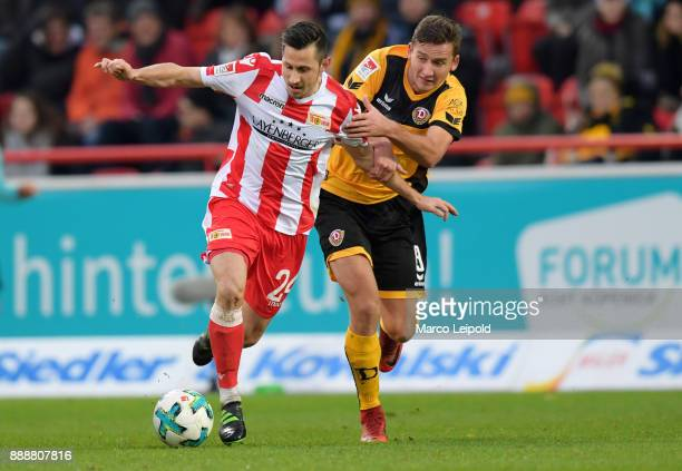 Steven Skrzybski of 1 FC Union Berlin and Paul Seguin of SG Dynamo Dresden during the Second Bundesliga match between Union Berlin and Dynamo Dresden...