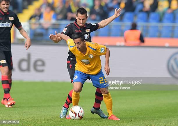 Steven Skrzybski of 1 FC Union Berlin and Salim Khelifi of Eintracht Braunschweig during the Second Bundesliga match between Eintracht Braunschweig...
