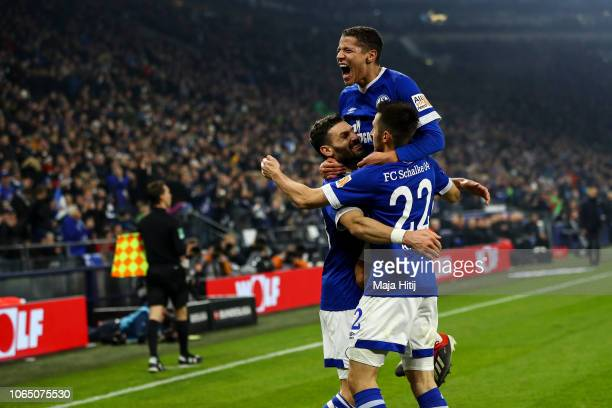 Steven Skrzybski of FC Schalke 04 celebrates with Daniel Caligiuri and Amine Harit after scoring his team's fourth goal during the Bundesliga match...