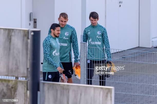 Steven Skrzybski of FC Schalke 04 , Timo Becker of FC Schalke 04 and Benito Raman of FC Schalke 04 look on during the FC Schalke 04 Training Session...