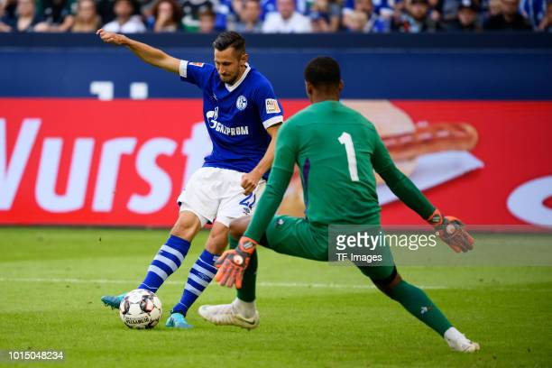 Steven Skrzybski of Schalke scores the team`s second goal and goalkeeper Alban Lafont of Fiorentina in action during the friendly match between FC...