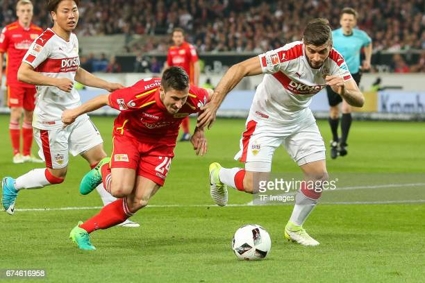 Steven Skrzybski of Union Berlin and Emiliano Adriano Insua of Stuttgart battle for the ball during the Second Bundesliga match between VfB Stuttgart...
