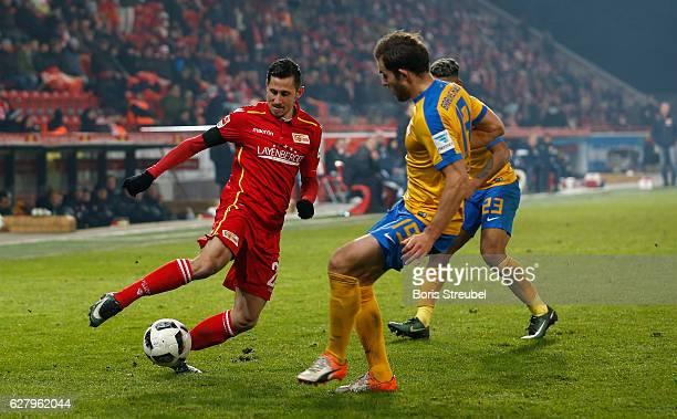 Steven Skrzybski of Union Berlin is challenged by Ken Reichel of Eintracht Brauschweig during the Second Bundesliga match between 1 FC Union Berlin...