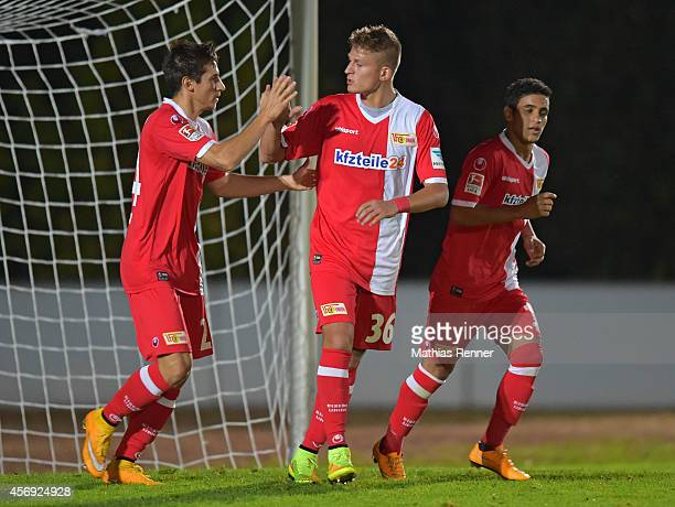 Steven Skrzybski, Tugay Uzan and Abdallah Gomaa of 1 FC Union Berlin celebrate during the friendly match between FC Strausberg and 1 FC Union Berlin...