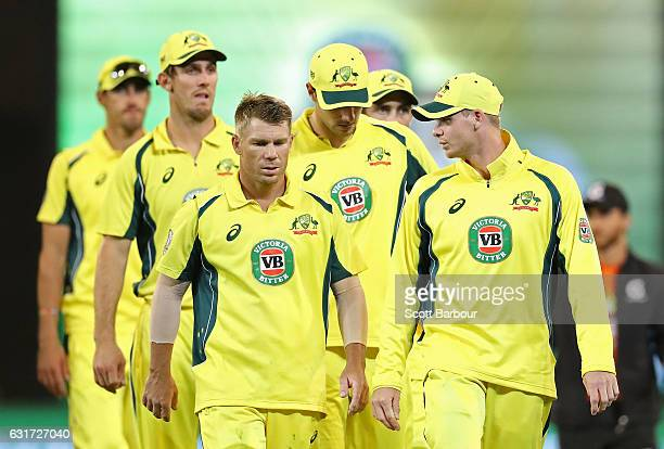 Steven Smith and David Warner of Australia lead Australia from the field after losing game two of the One Day International series between Australia...