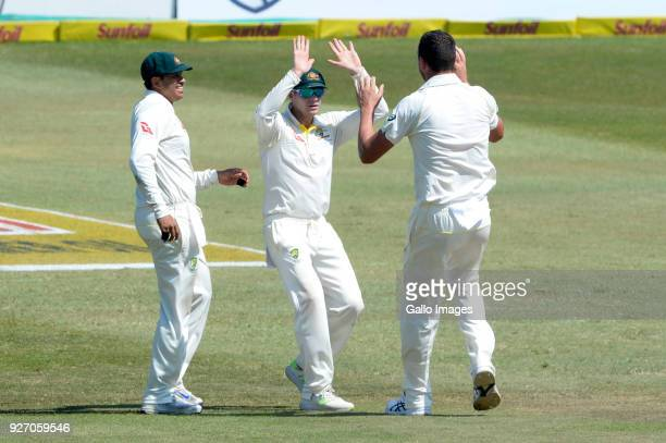 Steven Smith and Josh Hazlewood of Australia celebrate the wicket of Theunis de Bruyn of the Proteas during day 4 of the 1st Sunfoil Test match...