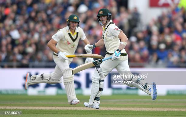 Steven Smith and Marnus Labuschagne of Australia run between the wickets during day one of the 4th Specsavers Ashes Test between England and...