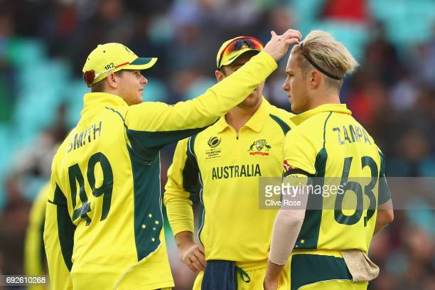 Steven Smith of Australia adjusts the hair of Adam Zampa during the ICC Champions trophy cricket match between Australia and Bangladesh at The Oval...