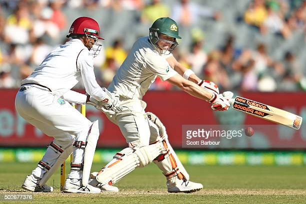 Steven Smith of Australia bats as wicketkeeper Denesh Ramdin of the West Indies looks on during day three of the Second Test match between Australia...