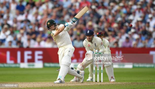 Steven Smith of Australia bats watched by England wicketkeeper Jonathan Bairstow during day one of the 1st Specsavers Ashes Test between England and...