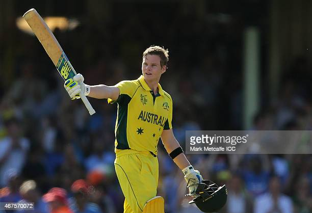 Steven Smith of Australia celebrates and acknowledges the crowd after scoring a century during the 2015 Cricket World Cup Semi Final match between...