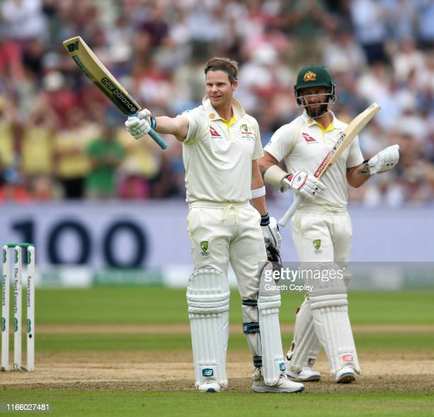 Steven Smith of Australia celebrates reaching his century alongside Matthew Wade during day four of the 1st Specsavers Ashes Test between England and...