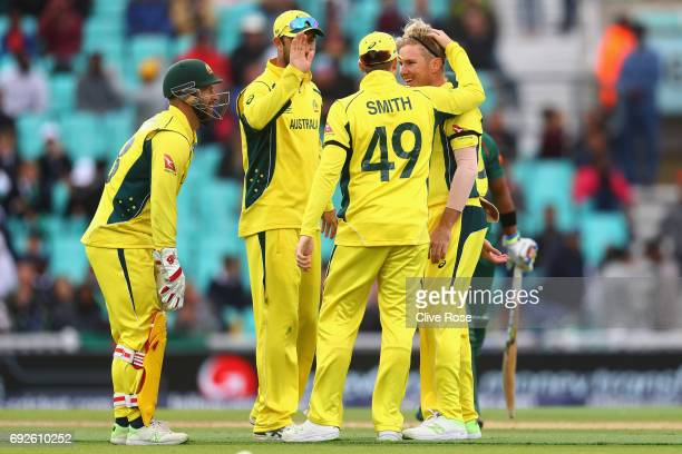 Steven Smith of Australia congratulates Adam Zampa on his second wicket during the ICC Champions trophy cricket match between Australia and...