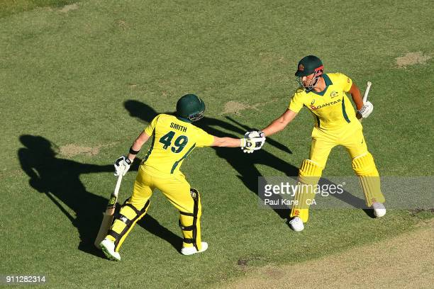 Steven Smith of Australia congratulates Marcus Stoinis of Australia after reaching his half century during game five of the One Day International...