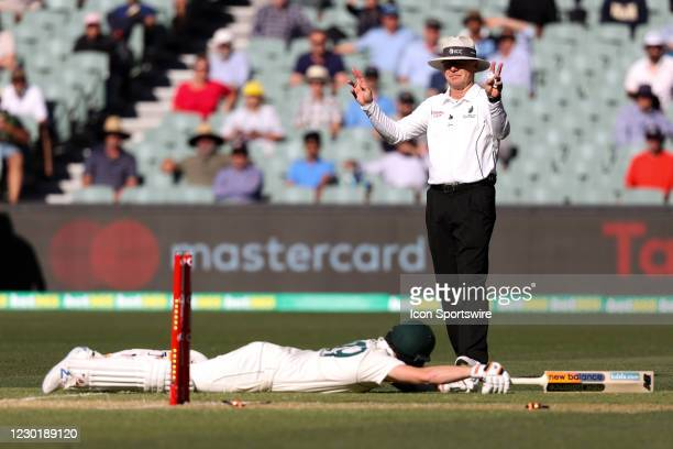 Steven Smith of Australia dives for crease during day two of the First Vodafone Test cricket match between Australia and India at the Adelaide Oval...
