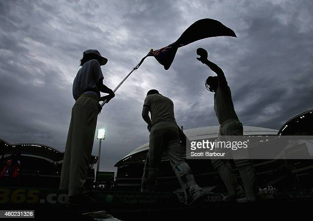 Steven Smith of Australia reaches up to touch the Australian flag as he walks out to bat with Michael Clarke during day two of the First Test match...
