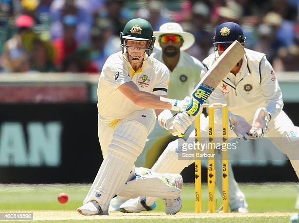 Steven Smith of Australia reverse sweeps during day two of the Third Test match between Australia and India at Melbourne Cricket Ground on December...