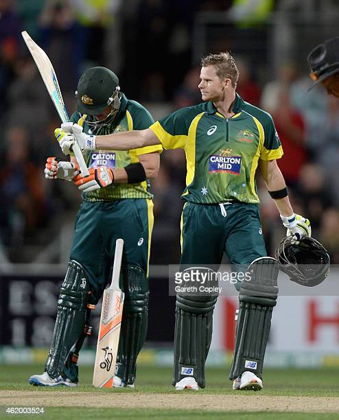 Steven Smith of Australia salutes the crowd after reaching his century during the One Day International Tri Series match between Australia and...