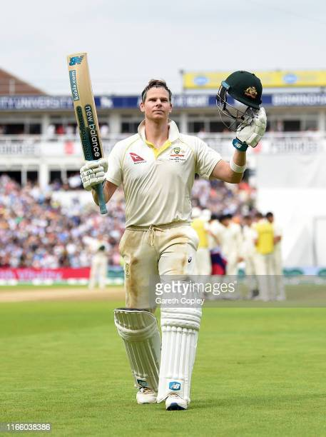 Steven Smith of Australia salutes the crowd as he leaves the field after being dismissed by Chris Woakes of England during day four of the 1st...