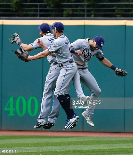 Steven Souza Jr #20 and Peter Bourjos and Kevin Kiermaier of the Tampa Bay Rays celebrate after beating the Cleveland Indians 74 at Progressive Field...