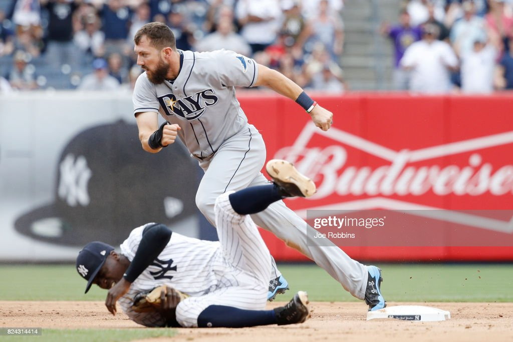 Steven Souza Jr. #20 of the Tampa Bay Rays advances to third base after an error and collision with Didi Gregorius #18 of the New York Yankees in the ninth inning of a game at Yankee Stadium on July 29, 2017 in the Bronx borough of New York City. The Yankees defeated the Rays 5-4.