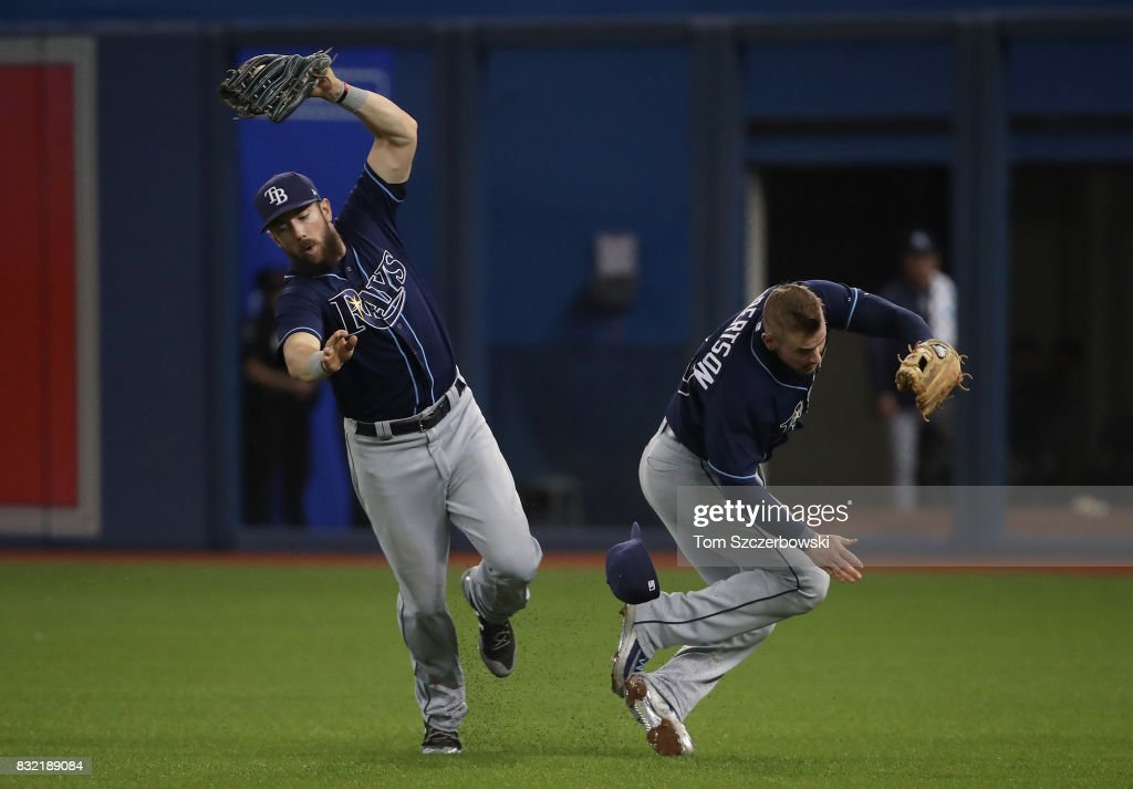 Steven Souza Jr. #20 of the Tampa Bay Rays catches a fly ball as he collides with Daniel Robertson #29 in the sixth inning during MLB game action against the Toronto Blue Jays at Rogers Centre on August 15, 2017 in Toronto, Canada.