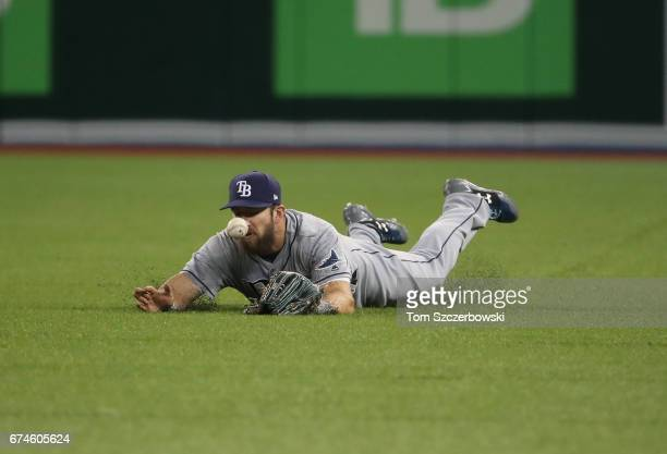 Steven Souza Jr #20 of the Tampa Bay Rays dives but cannot get to a single hit by Darwin Barney of the Toronto Blue Jays in the third inning during...